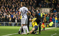 Millwall Manager Neil Harris rushes to pick up Danny Hylton of Oxford United as his team trail 2-1 on aggregate during the Johnstone's Paint Trophy Southern Final 2nd Leg match between Oxford United and Millwall at the Kassam Stadium, Oxford, England on 2 February 2016. Photo by Andy Rowland / PRiME Media Images.