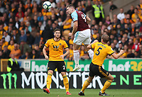 Burnley's Sam Vokes leaps ahead of Wolverhampton Wanderers' Matt Doherty and Wolverhampton Wanderers' Ryan Bennett<br /> <br /> Photographer Rachel Holborn/CameraSport<br /> <br /> The Premier League - Wolverhampton Wanderers v Burnley - Sunday 16th September 2018 - Molineux - Wolverhampton<br /> <br /> World Copyright &copy; 2018 CameraSport. All rights reserved. 43 Linden Ave. Countesthorpe. Leicester. England. LE8 5PG - Tel: +44 (0) 116 277 4147 - admin@camerasport.com - www.camerasport.com