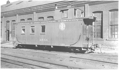 Caboose #0586 at Salida.  Roundhouse in background.<br /> D&amp;RGW  Salida, CO  Taken by Best, Gerald M.
