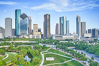 This is a aerial view of the Houston Skyline with the Buffalo Bayou, Elenor Tinsley Park and the Jaimal Skate Park all in the image below. You can also see the Sabine St. Bridge along with the Allen Parkway and on the other side is Memorial drive running along the other side of the park.  The city view includes the usual skyscrapers like the Chase Tower, Heritage Plaza, Wells Fargo, and the 1400 Smith St. buildings just to name a few.  You can see the Houston City Hall building at the base of the buildings where it is dwarfed by the high-rise skyscrapers since Houston has some ot the tallest buildings in the southern US.