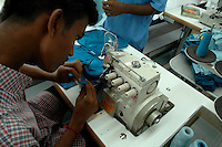 An indian man working at Srinidhi Industry's garment stitching factory in Tirupur, Tamilnadu. After lifting of quota system in textile export on 1st january 2005. Tirupur has become the biggest foreign currency earning town of India.