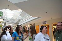 (L-R) Courtney Rennier, 15, Jennifer Grim, 18, Jessica Grim, 16, with Jennifer and Jessica's parents, Janet Grim, 50, and Jay Grim, 49, of Springfield, Illinois go back to school shopping with their extended family and parents at the Woodfield Mall in Schaumburg, Illinois on September 5, 2010.