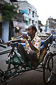 A rickshaw puller takes a tea break in Lucknow, India.
