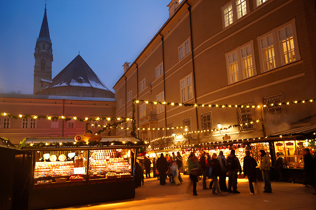 Christmas market stalls at night with Christams lights  at Satlzburgh market - Austria