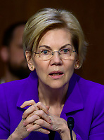 """United States Senator Elizabeth Warren (Democrat of Massachusetts) questions witnesses during testimony before the US Senate Committee on Armed Services during a hearing on """"Chain of Command's Accountability to Provide Safe Military Housing and Other Building Infrastructure to Service members and Their Families"""" on Capitol Hill in Washington, DC on Thursday, March 7, 2019.<br /> Credit: Ron Sachs / CNP/AdMedia"""