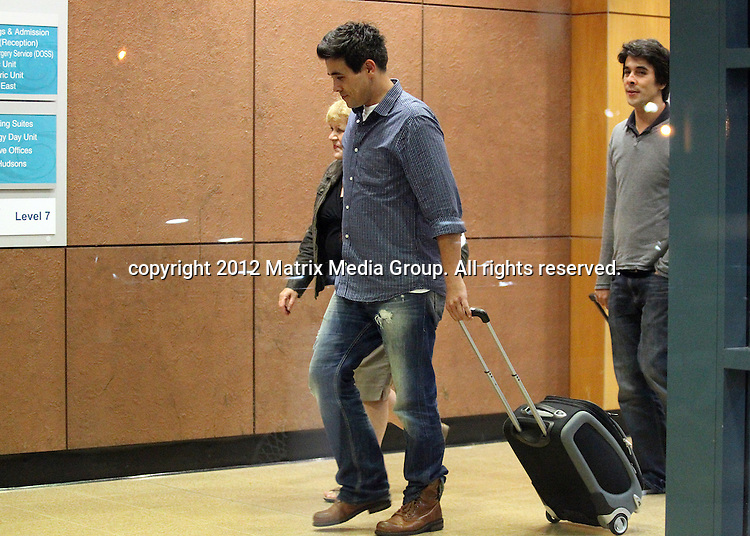 8 May 2012 Sydney, Australia..***EXCLUSIVE***..Jessica Marais arrives at hospital with fiance James Stewart and her mother ready to give birth to their first child. James is pictured meeting his family including brother Nick and his mother - getting some coffees and sharing a cigarette with the obstitrician.