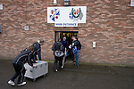 Cowdenbeath 0 Dundee 3, 18/08/2009. Central Park, Alba Challenge Cup. Dundee players bringing equipment into the main entrance of Central Park, prior to the Alba Challenge Cup second round tie between Cowdenbeath and Dundee. The visitors won by 3 goals to nil. The Challenge Cup is open to all Scottish League clubs. Cowdenbeath's Central Park was opened in in the Fife town in 1917 and also hosts stock car racing and a weekly open air market. Photo by Colin McPherson.