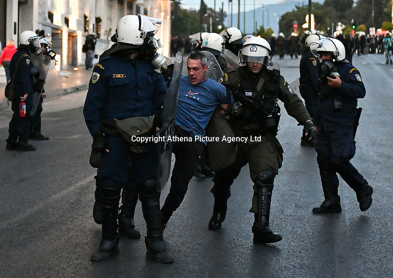 Pictured: A protester is arrested by riot police officers Sunday 09 May 2016<br /> Re: Riots break out between protesters and police in Syntagma Square, while MPs in the Greek Parliament vote for new tax, pension and welfare reforms in Athens, Greece