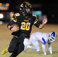 NWA Democrat-Gazette/ANDY SHUPE<br /> Blake Faulk (20) of Prairie Grove runs past Eric Briggs of Star City Friday, Nov. 27, 2015, during the first half of play at Tiger Stadium in Prairie Grove. Visit nwadg.com/photos to see more photographs from the game.