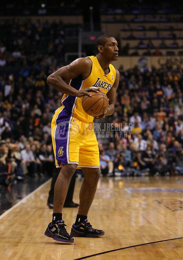 Jan. 30, 2013; Phoenix, AZ, USA: Los Angeles Lakers forward Metta World Peace (15) against the Phoenix Suns at the US Airways Center. Mandatory Credit: Mark J. Rebilas-