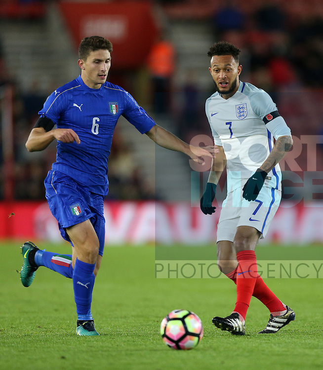 England's Lewis Baker tussles with Italy's Mattia Caldara during the Under 21 International Friendly match at the St Mary's Stadium, Southampton. Picture date November 10th, 2016 Pic David Klein/Sportimage