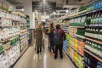Shoppers in the new Whole Foods Market in Newark, NJ on opening day Wednesday, March 1, 2017. The store is the chain's 17th store to open in New Jersey. The 29,000 square foot store located in the redeveloped former Hahne & Co. department store building is seen as a harbinger of the revitalization of Newark which never fully recovered from the riots in the 1960's.  (© Richard B. Levine)