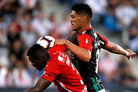 SANTIAGO DE CHILE - CHILE: 06-02-2019: Lucas Passerini de Club Deportivo Palestino  (CHL) disputa el balón con Jesús Murillo de Deportivo Independiente Medellín (COL), durante partido de la Segunda fase, llave 4, entre Club Deportivo Palestino (CHL) y Deportivo Independiente Medellín (COL), por la Copa Conmebol Libertadores 2019 en el estadio San Carlos de Apoquindio, de la ciudad de Santiago de Chile. / Lucas Passerini of Club Deportivo Palestino (CHL), vies for the ball with Jesús Murillo of Deportivo Independiente Medellin (COL), during a match between Club Deportivo Palestino (CHL) and Deportivo Independiente Medellin of the second phase, key 4, for Copa Conmebol Libertadores 2019 at the San Carlos de Apoquindio stadium, in the city of Santiago de Chile. Photos: VizzorImage / Andrés Piña / Cont. / Photosport