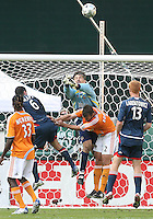 Houston goalkeeper Pat Onstad punches clear as Eddie Robinson #2 of Houston clears Jay Heaps#6 of New England from the play. The Houston Dynamo defeated the New England Revolution 2-1 in the finals of the MLS Cup at RFK Memorial Stadium in Washington, D. C., on November 18, 2007.