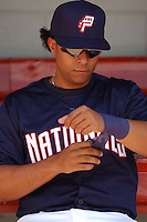 Catcher Erick San Pedro (5) of the Potomac Nationals, Class A Carolina League affiliate of the Washington Nationals, tapes his wrist before a game on September 5, 2005, at Pfitzner Stadium in Woodbridge, Virginia. (Tom Priddy/Four Seam Images)