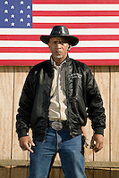 2 December 2006 - New York City, NY - Eric Jackson, aka Cowboy Little Red, a member of the Federation of Black Cowboys, poses for the photographer at the Cedar Lanes stables in the borough of Queens in New York City, USA, 2 December 2006. The Federation gathers black men and women who recreate the heritage of black cowboys, teach kids to ride and put on 'rodeo showdeos'.