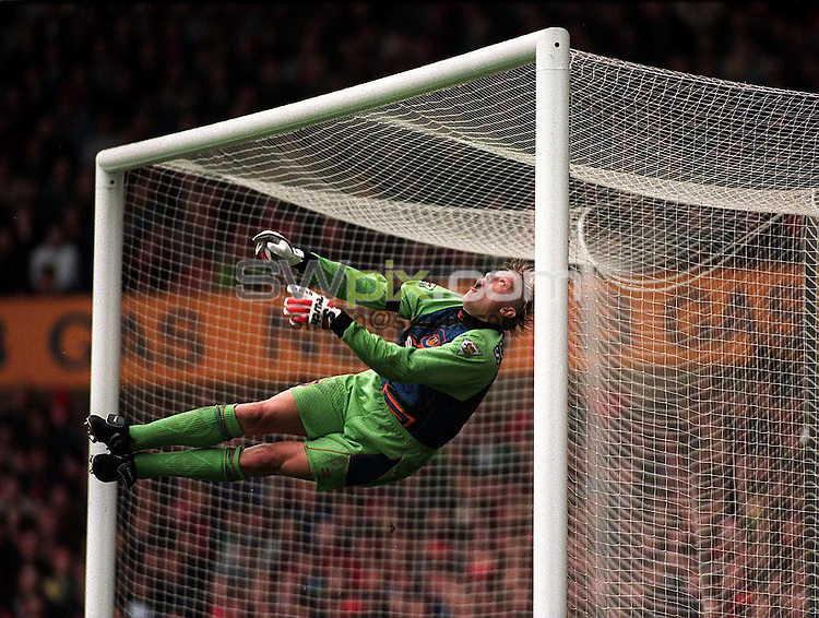 Pix: Michael Steele/SWpix.com. Soccer, Manchester United. Peter Schmeichel, Old Trafford 1996...COPYWRIGHT PICTURE>>SIMON WILKINSON>>01943 436649>>..Manchester United goalkeeper Peter Schmeichel, makes a spectacular save.