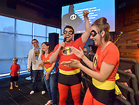 NWA Democrat-Gazette/BEN GOFF -- 05/29/15 Pastor Joe Liles cheers for his wife Jessica Liles during the the adult costume contest at the Popcorn Theology program at The Neighborhood Church in Bentonville on Friday May 29, 2015.Popcorn Theology programs feature a movie, this time the film was 'The Incredibles,' followed by a discussion of where religious themes could be seen in the movie.