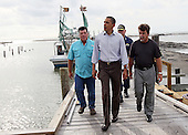 United States President Barack Obama is greeted by Mayor David Camardelle (R) of Grand Isle and Chris Camardelle (L) during a visit Friday, June 4, 2010 in Grand Isle, Louisiana. This is President Obama's third visit to the State of Louisiana since the Deepwater Horizon incident in the Gulf of Mexico..Credit: Win McNamee - Pool via CNP