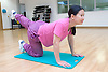 Woman doing floor exercising in an aerobics class at her sports leisure centre,