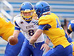 BROOKINGS, SD - APRIL 26:  Quarterback Dalton Douglas #8 from South Dakota State's offense hands the ball off to Brady Mengarelli #44 during their spring game Saturday at Coughlin Alumni Stadium in Brookings. (Photo by Dave Eggen/Inertia)
