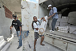 Workers unload tents and other emergency supplies in preparation for a distribution by the Lutheran World Federation, a member of the ACT Alliance, in the village of Gressier outside of Port-au-Prince, Haiti. A January 12 earthquake ravaged the Caribbean nation, leaving hundreds of thousands hungry and increasingly frustrated and desperate.