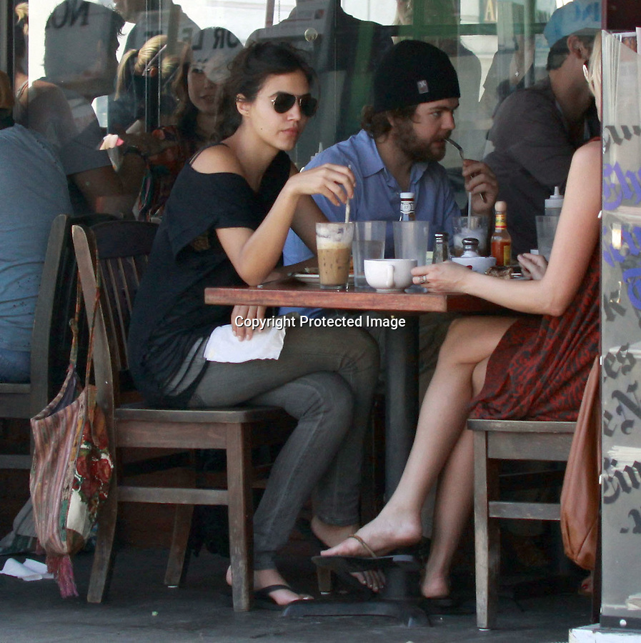10-25-09.Exclusive..Jack Osbourne waited 20 minutes with his girlfriend for a table outside of the restaurant Kings Road Café in west Hollywood. Jack didn't seem to mind the long wait & spent most of the time playing with his huge beard.  Jack didn't eat very much & spent most of his breakfast time texting on his phone. ...AbilityFilms@yahoo.com.805-427-3519.www.AbilityFilms.com