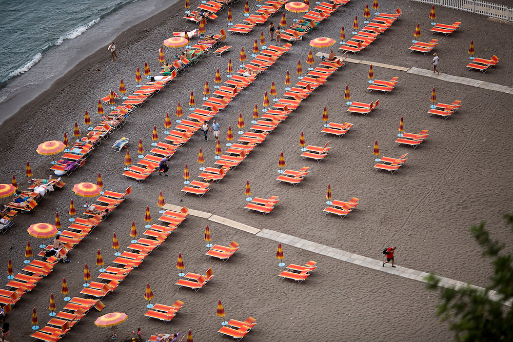 Sunbathers enjoy a private beach on Sunday, Sept. 20, 2015, in Positano, Italy. (Photo by James Brosher)