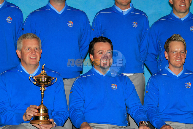 Captain Colin Montgomerie with Luke Donald and Graham McDowell at the European Team pictures in the caddy car shed during Practice Day 2 at the 2010 Ryder Cup at the Celtic Manor Twenty Ten Course, Newport, Wales, 29th September 2010..(Picture Eoin Clarke/www.golffile.ie)