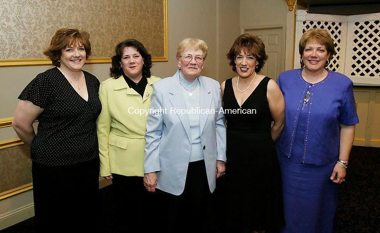 WATERBURY, CT, 28 April 2006- 042806BZ09- From left- Rhonda Baker Nonamaker, of Wolcott; Kim Baker Jacovich, of Waterbury; Mary Baker, of Waterbury, mother of the four girls; Kathy Baker Breidenbach, of Waterbury; and MaryBeth Baker Gallo, of Watertown;<br /> at the fifth annual Friends of SS. Peter and Paul School awards dinner at the Villa Rosa in Waterbury Friday night.  All four daughters attended SS. peter and Paul School. <br /> Jamison C. Bazinet Republican-American