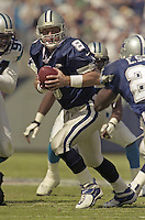 Quarterback Troy Aikman looks for a receiver as the Dallas Cowboys beat the Carolina Panthers ar Ericsson Stadium in Charlotte, NC, October 1, 2000.  (Photo by Brian Cleary/www.bcpix.com)