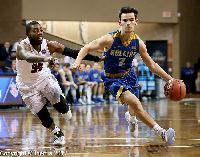 SIOUX FALLS, SD: MARCH 22: Connor Mckim #2 from Rollins drives past Shammgod Wells #55 from Fairmont State during the Men's Division II Basketball Championship Tournament on March 22, 2017 at the Sanford Pentagon in Sioux Falls, SD. (Photo by Dave Eggen/Inertia)