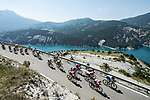 The 34 man breakaway group ride along the Lac de Serre-Ponçon during Stage 18 of the 2019 Tour de France running 208km from Embrun to Valloire, France. 25th July 2019.<br /> Picture: ASO/Alex Broadway | Cyclefile<br /> All photos usage must carry mandatory copyright credit (© Cyclefile | ASO/Alex Broadway)