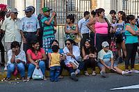 Lima, Peru.  Spectators Watching Andean Cultural Parade, Plaza de Armas.