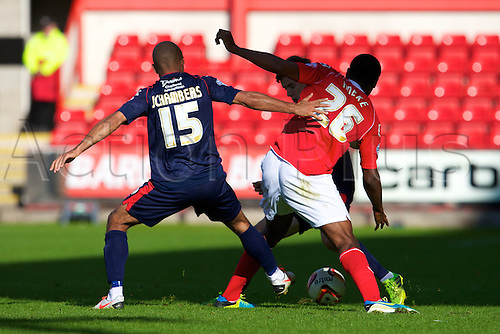 14.09.2013 Crewe, England. Walsall FC defender James Chambers and Crewe Alexandra Chuks Aneke in action during the League One game between Crewe Alexandra and Walsall FC from the Alexandra Stadium