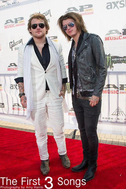 Danny Worsnop and Ben Bruce of Asking Alexandria attends the 2014 AP Music Awards at the Rock And Roll Hall Of Fame and Museum at North Coast Harbor in Cleveland, Ohio.