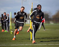 Pictured L-R: Angel Rangel chases Marvin Emnes Thursday 25 February<br />Re: Swansea City FC training at Fairwood, near Swansea, Wales, UK, ahead of their game against Tottenham Hotspur.