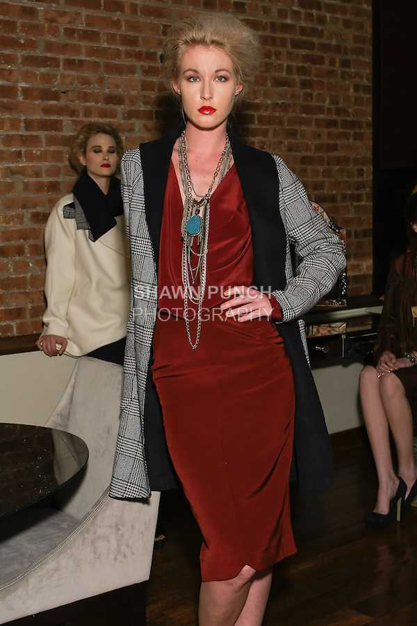 Model poses in an outfit from the Christine Alcalay Autumn/Winter 2012 collection presentation, during New York Fashion Week Fall 2012.
