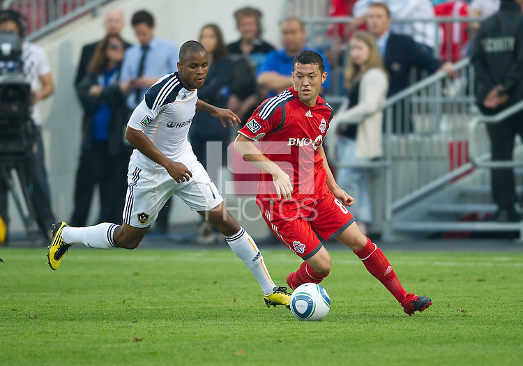 26 June 2010: Toronto FC defender Dan Gargan #8 and Los Angeles Galaxy forward Tristan Bowen #17 battle for a ball during a game between the Los Angeles Galaxy and the Toronto FC at BMO Field in Toronto..Final score was 0-0...