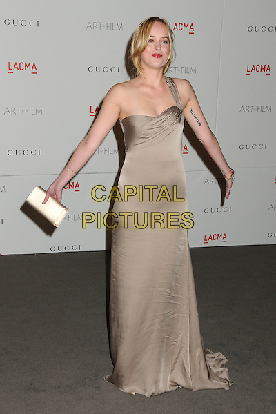 Dakota Johnson.The Inaugural Art and Film Gala held at LACMA in Los Angeles, California, USA..November 5th, 2011.full length beige dress one shoulder  hands arms tattoo.CAP/ADM/BP.©Byron Purvis/AdMedia/Capital Pictures.