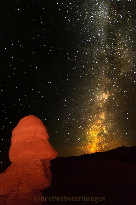 An Easter Island-like formation near the San Rafael Swell in Utah observes the galaxy and the galaxy observes him back.