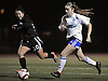 Nassau Team No. 8 Nicole O'Connell (Carle Place HS), right, moves a ball downfield under pressure from Suffolk No. 30 Julia Venezia (Longwood HS) during the second of two Long Island varsity girls' soccer senior all-star games at Bethpage High School on Friday, November 27, 2015.<br /> <br /> James Escher