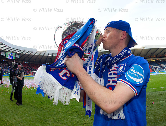 Goalscorer Kenny Miller kisses the League Cup