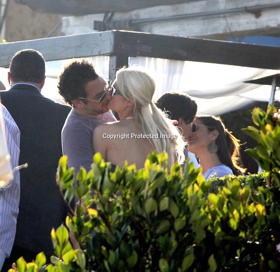 2011.July 3rd Exclusive ...Paris Hilton hugging & kissing director Todd Phillips at a beach house party in Malibu California.  Gerard Butler & Bradley Cooper also attended the pre-4th of July party ..AbilityFilms@yahoo.com.805-427-3519.www.AbilityFilms.com