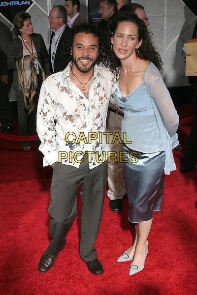 """MICHAEL IRBY & GUEST.Arrivals for the premiere of """"Flight Plan"""" at El Capitan Theatre, Hollywood,.Los Angeles, 20th September 2005.full lengthwhite shirt beard grey gray trousers.Ref: ADM/ZL.www.capitalpictures.com.sales@capitalpictures.com.© Capital Pictures."""