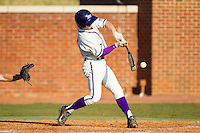 Chris Clare (9) of the High Point Panthers makes contact with the baseball against the Bowling Green Falcons at Willard Stadium on March 9, 2014 in High Point, North Carolina.  The Falcons defeated the Panthers 7-4.  (Brian Westerholt/Four Seam Images)