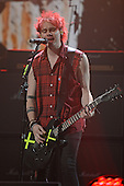 SUNRISE FL - DECEMBER 18: Michael Clifford of 5 Seconds Of Summer performs at the Y100 Jingle Ball 2015 held at The BB&T Center on December 18, 2015 in Sunrise, Florida. (Photo by Larry Marano © 2015