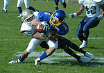 Chad Westendorf of SD Tech brings down Cedric Ho of Dakota State University in the first quarter of their game Saturday, October 20, 2007 in Madison, SD. (photo by Ty Carlson/Inertia)