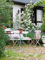 The secluded, cobbled courtyard beside the house makes an ideal relax on a summer day