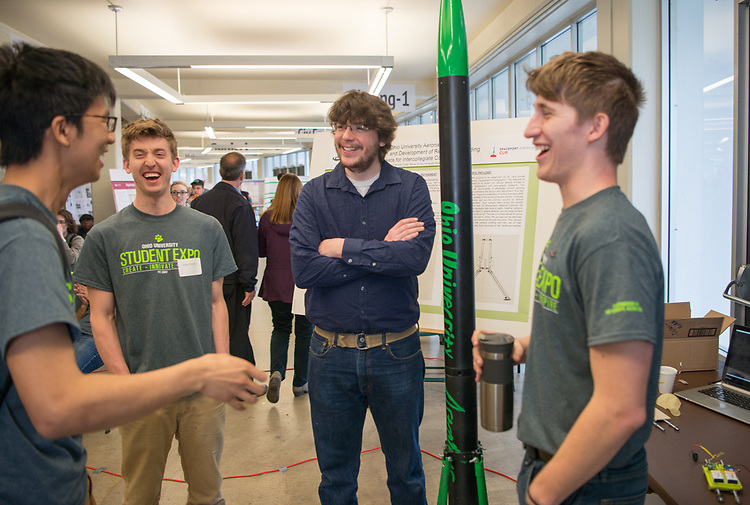 (Left to Right) Yonry Zhu, Kane Pickrel, Jeremy Brown and Dylan Danner discuss rocket launching at Ohio University's Student Research and Creative Activity Expo. Photo by Ben Siegel
